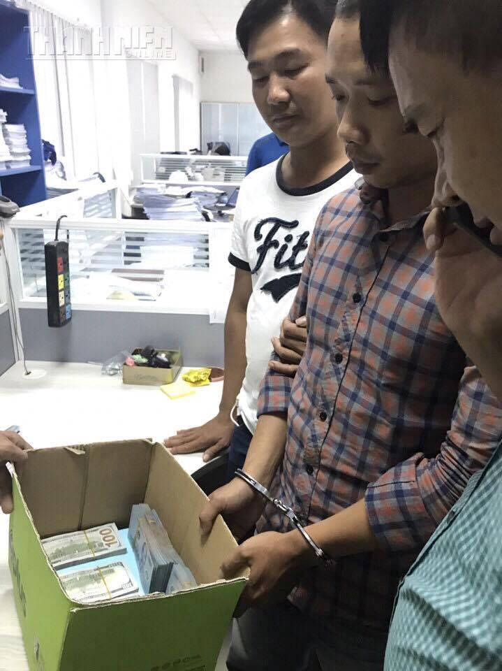 Lê Lâm Hưng và số tiền 35.900USD thu giữ được