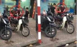 Chồng vũ phu đánh vợ chảy máu mặt ngay ở đường phố Hà Nội mặc con gào khóc van xin