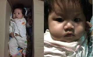 Bé gái khoảng 5 tháng tuổi bị bỏ rơi trong thùng catton trước cửa nhà dân rất ngoan, không quấy khóc