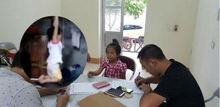 Vụ bé gái bị treo tay trên xà nhà: Mẹ nuôi chủ động nhờ người làm quay clip để gửi cho ông bà nội xem