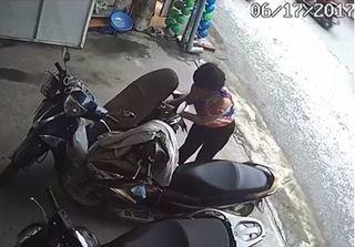 Clip nữ quái đi xế xịn trộm tiền trong cốp xe ở Hải Dương