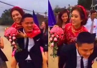 Đám cưới HOT ngày bão: Chú rể lội nước, hạnh phúc cõng cô dâu gây