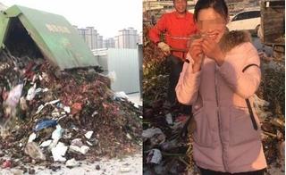 Gần chục người xắn tay đào bới 13 tấn rác truy tìm nhẫn kim cương