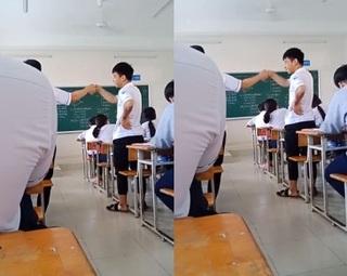 Làm việc riêng trong lớp, hai nam sinh phải đứng bắt tay cả tiết học