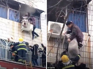 Người đàn ông tay không trèo cửa sổ giải cứu bà bầu từ đám cháy