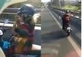 Clip HOT: 'Nữ ninja' phóng nhanh xe máy trên cầu vượt, bỏ hai tay lái để châm thuốc