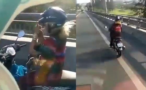 Nữ ninja phóng nhanh xe máy trên cầu vượt, bỏ hai tay lái