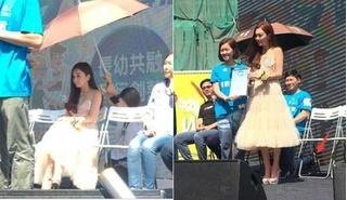 'Dâm phụ lẳng lơ nhất màn ảnh Hoa ngữ' bị chỉ trích vì để trợ lý quỳ gối che ô giữa trời nắng