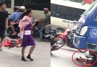 Đang đi đường, tài xế xe tải 'mét mặt' vì người phụ nữ chui vào gầm 'cố thủ'