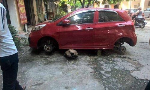 Kia Morning bị trộm tháo cả 4 bánh12