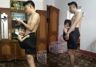 Clip 'hot': Bé trai 19 tháng ngủ ngoan trong 1 phút nhờ 'chui vào quần bố'