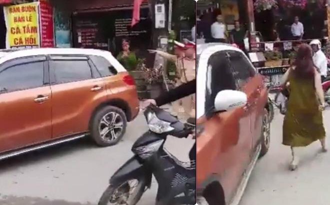 Phẫn nộ nữ tài xế đỗ ô tô 7 chỗ chắn ngang đường trước mặt CSGT