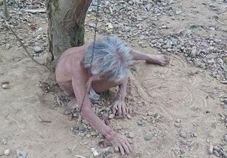 Câu chuyện đau lòng sau bức hình người đàn bà cởi trần bị xích ở gốc cây