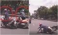 Clip: Mải tám chuyện, 2 'ninja' ngã lăn quay trước bánh xe ô tô