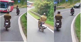 Công an làm việc với người đi xe máy buông cả hai tay đổ đèo Prenn