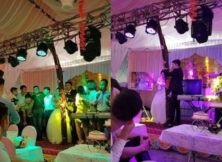 Món quà cưới 'lầy lội: Cô dâu cầm vợt muỗi, chú rể ôm bó mía trên sân khấu