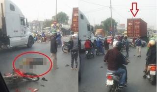 Hai người đi xe máy bị thương nặng sau va chạm với xe container