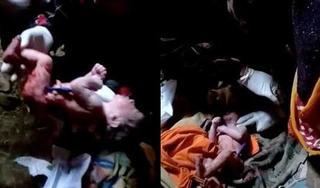 Phát hiện bé sơ sinh dây rốn vẫn nối liền với người mẹ đã tử vong