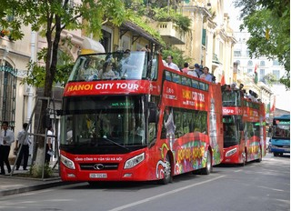 PV đưa tin Hội nghị Thượng đỉnh Mỹ-Triều được đi xe bus 2 tầng miễn phí