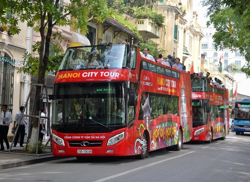 Miễn phí cho PV quốc tế đưa tin hội nghị thượng đỉnh Mỹ-Triều đi xe bus 2 tầng