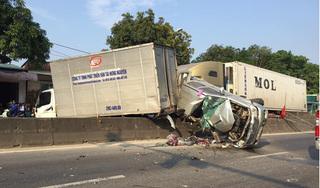 Container tông biến dạng xe bán tải đang chờ đèn đỏ, 2 người nhập viện