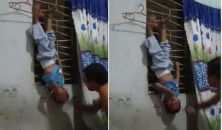 Chồng treo con trai lên đánh đập dã man để ép vợ quay về
