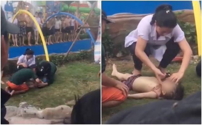 Bé trai 4 tuổi đuối nước đang được sơ cứu trước khi đưa vào bệnh viện. Ảnh cắt từ clip.