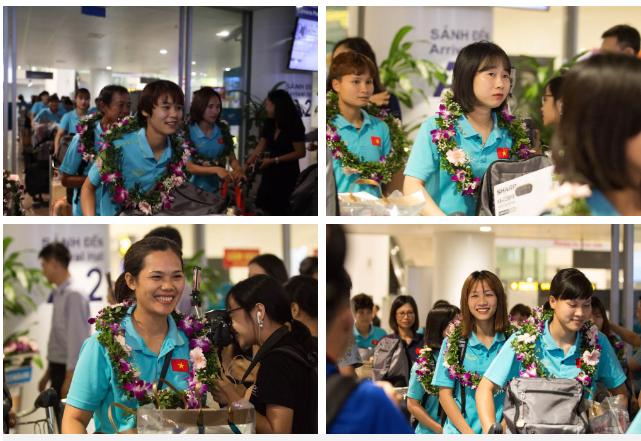 Tuyển nữ Việt Nam trở về trong sự chào đón của người hâm mộ