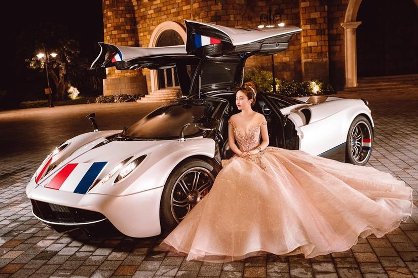Vợ chồng đại gia Minh Nhựa khoe loạt ảnh xuất thần bên siêu xe2