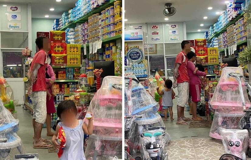 Hình ảnh ông bố người lấm lem sơn đưa hai con nhỏ vào cửa hàng sữa