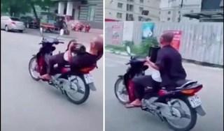 Ông cụ 62 tuổi không đội mũ bảo hiểm, buông 2 tay khi lái xe máy bị phạt nặng