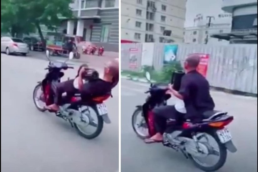 Ông cụ 62 tuổi buông 2 tay khi lái xe máy bị phạt nặng