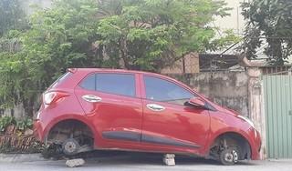Đậu ngoài đường, xe ô tô bị trộm mất 4 bánh