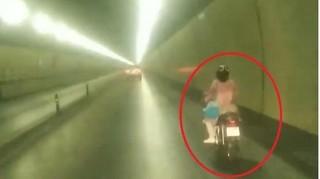 Truy tìm người phụ nữ liều lĩnh đi xe máy qua hầm Hải Vân