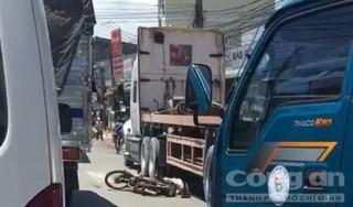Băng qua giao lộ, người đàn ông đi xe máy bị container cán tử vong