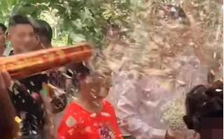 Bắn pháo giấy thẳng mặt chú rể khi đang rước dâu, nam thanh niên bị 'ném đá'