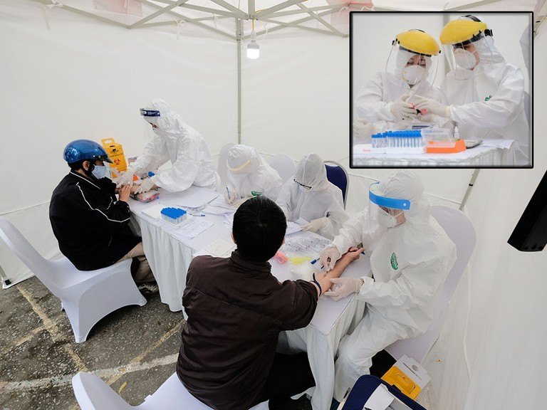 Lấy mẫu test nhanh Covid-19 tất cả 21.000 người Hà Nội về từ Đà Nẵng