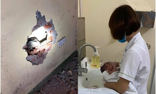 Đục tường cứu bé sơ sinh bị vứt bỏ trong khe tường giữa hai nhà