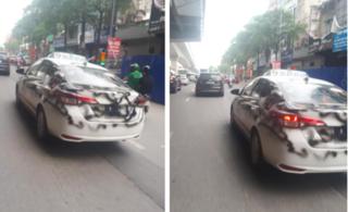 Xôn xao hình ảnh taxi trắng bị phun sơn đen chạy khắp phố