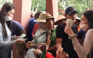 Thủy Tiên phải tạm dừng phát tiền cứu trợ vì người dân chen lấn hỗn loạn