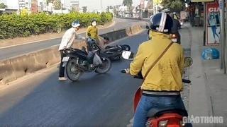 Xe tải chở dầu đổ ra đường khiến nhiều phương tiện trượt ngã