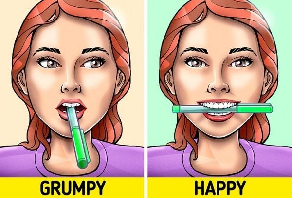 Vì sao ngậm một cây bút chì trong miệng có thể hạnh phúc hơn