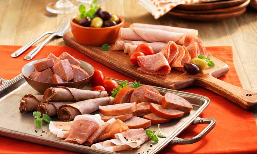 Những món ăn bà bầu cần hạn chế trong dịp Tết để an toàn cho sức khỏe của mẹ và bé