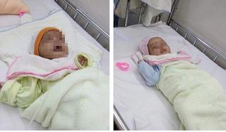 Hai bé sơ sinh bị bỏ rơi ngoài cổng chùa kèm bình nước gạo pha với đường