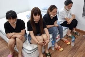 11 người Trung Quốc nhập cảnh trái phép cố thủ trong chung cư ở Hà Nội