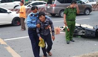 Chồng khóc ngất ôm thi thể vợ bị xe tải cán chết trên đường về quê làm căn cước công dân